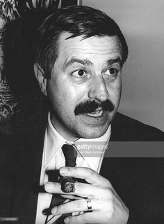 Portrait of German author Gunter Grass as he holds a cigar, 1961.