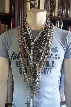 Collection of Rosary beads displayed on a mannequin