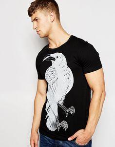 """T-shirt par Vacant Jersey de coton Ras du cou Motif à imprimé oiseau Coupe classique taillant normalement Lavage en machine 100% coton Le mannequin porte l'article en taille Medium et mesure 185,5 cm (6'1"""")"""
