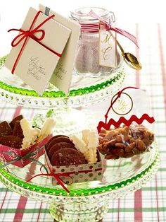 Cookie and nut sampler    An assortment of baked goodies fills holiday-printed boxes trimmed with ribbon. Add treats of different sizes and colors such as our Lemony Spritz Cookies, Chocolatey Shortbread Bites and Sugared Almonds. Then gather the boxes on a festive cake stand, ready to give away as party favors.    Lemony Spritz Cookies    Chocolatey Shortbread Bites    Sugared Almonds