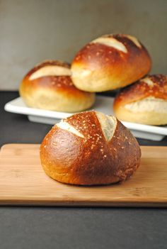 Pretzel Hamburger Buns Ingredients (makes 8-10 buns) Pretzel Dough: 4 1/2c all purpose flour 2t Kosher salt 1 1/2c warm water 1T sugar 1 3/4t active dry yeast 4T unsalted butter, melted Baking the Buns: 10c water 2/3c baking soda 1 large egg, whisked with a dash of water Kosher salt for sprinkling