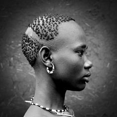Africa |  Bodi tribe woman haircut Ethiopia.  Image credit Eric Lafforgue