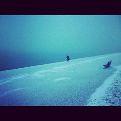 Den Helder was where we discovered how crazy the Dutch are about cycling. Took this photo on the edge of a cliff overlooking the North Sea. Somewhere on the other side of that blue haze is the UK. It was the middle of winter & this dude was happily pedalling home through gale force...  [Read more]: http://thesunpilots.com/photos/1431197624   #TheSunpilots #photoblog