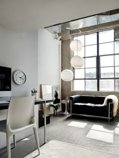 Amazing industrial loft in New York with grunge concrete walls, industrial style lightings and modern furniture