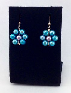 A personal favorite from my Etsy shop https://www.etsy.com/listing/498984426/blue-pearl-earringsdangle-earrings