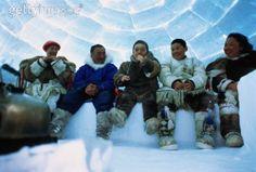 Inuit family in an igloo, Nunavut