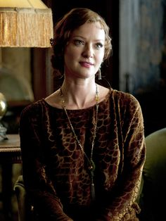 Boardwalk Empire - Gretchen Mol's Gillian is always classically tailored, and her early 20s styles are refined with some personalized accessories - she loves jade, for example.