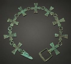 Byzantine bronze collar or belts formed by nine crosses with decoration of concentric circles, the buckle engraved with four Greek letters: ' TOMY '. Byzantine Jewelry, Medieval Jewelry, Byzantine Art, Ancient Jewelry, Old Jewelry, Metal Jewelry, Antique Jewelry, Jewelery, Fine Jewelry