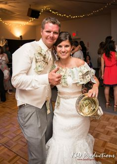 This bride and groom scored from their money dance! From Kaylie and Kurt's #reception at Moresi's Foundry in the Clifton Event Complex in Beaumont, TX.  #weddingmoments #weddingphotography #texasweddingphotographers #janddproductions #cuteweddingpictures #funweddingmoments #candidweddingmoments #candidweddingpictures #texasweddings #receptionfun #funweddings #weddingdancing #moneydance