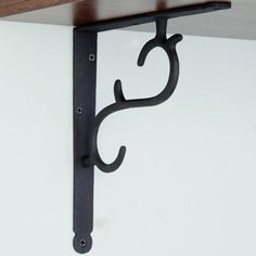 "Simple Scrollwork Cast Iron Shelf Bracket - $9.95 and 8 1/4"" wide"