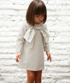 Cute haircut and adorable dress.