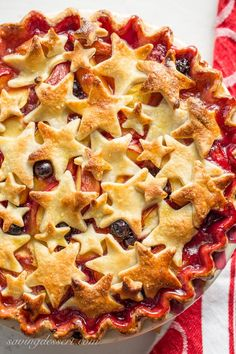 Nectarine Blueberry Pie ~ bake the season with this juicy, tangy, sweet pie filled with ripe nectarines and plump blueberries. Topped with a homemade flaky crust cut into shapes with your favorite cookie cutter, you'll be the star of your next celebration with this delicious dessert! www.savingdessert.com