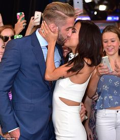 So in love: Kaitlyn Bristowe and Shawn Booth planted kisses on each other as they posed for photos in New York's Times Square on Tuesday