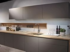 A great #modern #kitchen design with an added touch - don't you just love the recessed shelf?