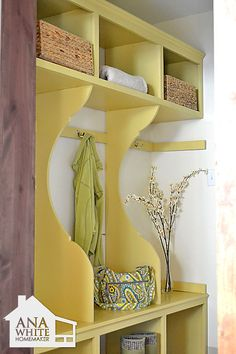 Mudroom plans. Uses 2 sheets PureBond Formaldehdye Free Plywood, some 1x2s and 1x3s, and a couple of sticks of trim, a gallon of  paint, and some hooks, for a grand total of 148.00. Make three shelves w/o partitions; no partition below bench.