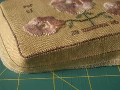 Mattress Pincushion tutorial.  In French but lots of good pics.  Mission matelas - Coté Passions http://verom.canalblog.com/archives/2006/11/16/3182816.html