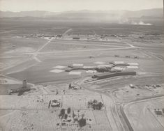 Vintage Las Vegas photo ~ McCarran Airport was expanded to accommodate the jet age, moving to its current Paradise Road location. With expanded runways and the new terminal shown, it opened this new phase in its history on March 15, 1963. This photo looks to the west, with the south Strip in the background. Los Angeles California, Southern California, Las Vegas Airport, Old Vegas, Virginia City, Las Vegas Photos, Airports, Historical Photos, Old Photos