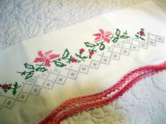 Vintage Embroidered Pillow Case in White by bethanyg13  Grandma would embroider these then take to a friend of hers to put on the edging.  I still have some of them