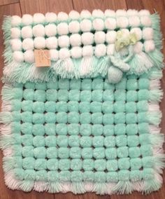 pom pom blanket in mint green                                                                                                                                                                                 More