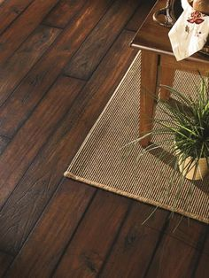 "For basements that double as rec rooms, he suggests wood-look porcelain tile. ""It gives you that relaxed bar look,"" he says, but with the durability and moisture resistance of ceramic. Wait up to a year before installing basement tile to give th Diy Wood Floors, Basement Flooring, Hardwood Floors, Plank Flooring, Wood Like Tile Flooring, Timber Flooring, Ceramic Wood Tile Floor, Porcelain Tiles, Wood Tiles"