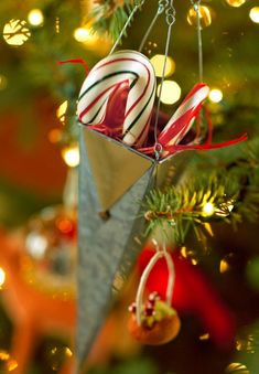 Candy canes hung in tin cones lend a  nostalgic holiday touch to the Christmas tree.