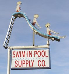 Swim In Pool Supply Company neon sign.