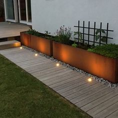 a neutral wooden garden path with a perfectly manicured lawn on one side and met., a neutral wooden garden path with a perfectly manicured lawn on one side and metal garden planters placed on pebbles on the other. Wooden Garden Planters, Diy Planters, Wooden Terrace, Terrace Garden, Garden Paths, Pea Gravel Garden, Landscape Design, Garden Design, Deck Design