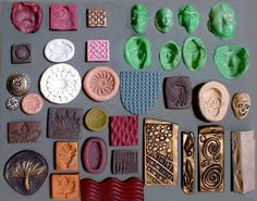 Inadvertently a great guide to how different colours work against a dark grey background, { actual post is MAKING MOLDS (from clay & for clay)}
