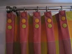 Colorful covered buttons on drapery pleats