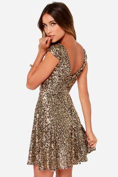 """LuLu*s Exclusive! The good life is only a shimmering dress away with the Livin' the Gleam Gold Sequin Dress! A sweetly scooping boat neck rounds between darling cap sleeves, topping off a fitted bodice and skater skirt adorned in sparkling gold sequins. A low-cutting V accent rests above the hidden zipper with clasp closure at back. Fully lined. Model is 5'8"""" and is wearing a size small. Self: 100% Polyester. Lining 1: 100% Polyester. Lining 2: 100% Rayon. Dry Clean Only. Imported."""