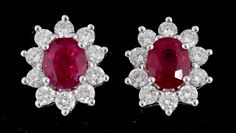 A PAIR OF RUBY AND DIAMOND CLUSTER EARRINGS IN WHITE GOLD, MARKED 750, 3.9G  Sold @ Mellors & Kirk