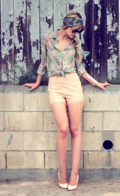 high waisted short shorts and a knotted shirt.