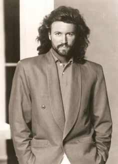 Barry Gibb.........*drool*  His high pitched voice and all his man-hair was HAWT!