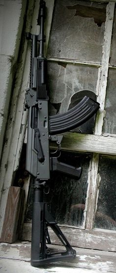 I want to shoot one of these! -JPM    AK in Sig Dark Grey by Joint Force Enterprises. - http://www.RGrips.com