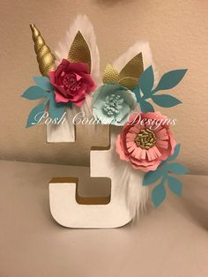 Unicorn Numbers  ~~~~~~Only Seen At Posh Couture Designs~~~~~   ~~~~~~~~Designed Exclusively ~~~~~~  By Posh Couture Designs   These beautiful Unicorn Numbers & Letters will add a touch of magic to your special event. These magical numbers are designed with beautiful handcrafted flowers that accent the fur mane, ears and horn!  These truly are beautiful and one of a kind creations that will give your party that high end party look!   After all, double digits are a magical milestone!! ----...