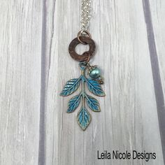 Leila Nicole Designs Blue Leaf Pendant with Copper Washer, Botanical Necklace, Gift Jewelry  - L11 by LeilaNicoleDesigns on Etsy https://www.etsy.com/listing/239987459/leila-nicole-designs-blue-leaf-pendant
