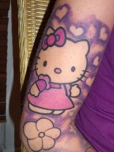 A gorgeous purple Hello Kitty and Powepuff tattoo. More Hello Kitty tattoos here: Hello Kitty Kawaii Skull Tattoo, Hello Kitty Zombie Tattoo, Hello Kitty On Tattoo Girls, Girls With Sleeve Tattoos, Arm Tattoos For Women, Tattoo Designs For Girls, Girly Tattoos, Body Art Tattoos, Tatoos, Kawaii Tattoos, Arm Tattos