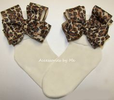 Leopard Bow Socks Safari Cheetah Animal Print Ivory Brown Ribbon Baby Toddler Infant Girls Accessories M2M Boutique Pageants Birthday Party by accessoriesbyme on Etsy https://www.etsy.com/listing/111556423/leopard-bow-socks-safari-cheetah-animal