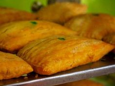 Descended from the British turnover, Jamaican beef patties liven up an old standby with a big pinch of curry and the fiery punch of the Scotch bonnet pepper. Jamaican Meat Pies, Jamaican Beef Patties, Jamaican Chicken, Jamaican Patty, Jamaican Cuisine, Jamaican Dishes, Jamaican Recipes, Chicken Curry, Butter Chicken
