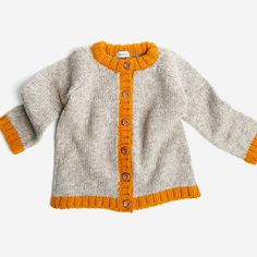 Pure Spanish wool long sleeved cardigan. Organic wooden buttons down the front. A timeless quality knit crafted in Spain to be cherished forever.