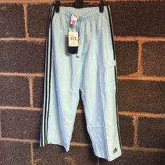 Womens Small AdidasIce Blue& Black  Peached Capri NWT Womens Small Iced Blue and Black Adidas Capris. These pants feature a small cargo pocket on the left pantleg. These pants measure 31 inches in length Adidas Pants Track Pants & Joggers