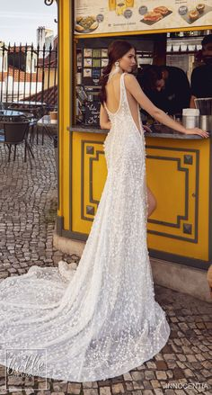 Innocentia Divina Wedding Dresses 2019 Lisboa Bridal Collection. Sparkly fitted sheath wedding dress with high slit deep v-neckline sleeveless #weddingdress#weddingdresses #bridalgown #bridal#bridalgowns #weddinggown#bridetobe #weddings #bride #dreamdress #bridalcollection #bridaldress#dress See more gorgeous wedding dresses by clicking on the photo