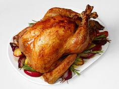 Good Eats Roast Turkey recipe from Alton Brown. I usually trust Alton Brown. I assume I can do this same method but stuff with stuffing instead of the apple, onion, etc. This just increases cooking time, I think. Best Thanksgiving Turkey Recipe, Thanksgiving Menu, Thanksgiving Traditions, Thanksgiving Activities, Alton Brown Roast Turkey, Food Network Recipes, Cooking Recipes, Cooking Tips, Vegetarian Recipes