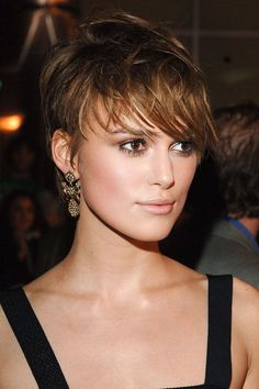 Due to an overlap in the filming schedule, Knightley wore a wig for her final scenes in Pride & Prejudice to cover the tough pixie cut she took on for her role as Domino Harvey, the Ford model turned bounty hunter. The wig wasn't needed on the red carpet, however, where she made the choppy ombré style every bit as romantic as anything Mr. Darcy would have wanted.   - ELLE.com