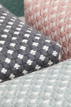 Wool woven on plastic lattice creates a hand-stitched look Plastic Lattice, Pouf Design, Plastic Canvas Stitches, Contemporary Embroidery, Weaving Textiles, Thread Art, Bargello, Canvas Crafts, Fabric Manipulation