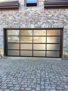 Full View Glass Garage Door With Black Frame And Tinted