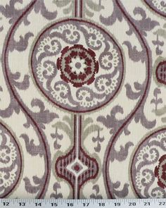 """Width: 54"""" Vertical Repeat: 13-1/8"""" Horizontal Repeat: 13-1/2"""" Row: 11B Contents: 100% Cotton Design: Ikat, Floral Brand: Magnolia Home Fashion   Fabric Type: Medium Weight Drapery / Light Weight Upholstery This beautiful ikat print has floral emblems and comes in ivory, burgundy, muted grape purple and gray. This fabric has a medium drape and is suitable for curtains, upholstery, pillows, duvets, shams, bags and much more!  $8.98/yd"""