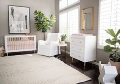 Pink + gray + just a touch of gold in this chic and stylish baby girl nursery.