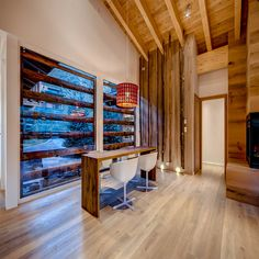 Vail Valley Home featuring European wide-plank engineered Oak floors in a custom finish with a ceiling of reclaimed Spruce. // Arrigoni Woods