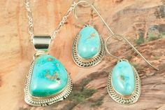"Genuine Castle Dome Turquoise set in Sterling Silver. Beautiful Pendant and Earrings Set. Free 18"" Sterling Silver Chain. The Castle Dome Turquoise Mine is located about 30 miles from the Sleeping Beauty Mine, near Globe, Arizona. The Castle Dome Mine has not been in operation since the early 1970s. The photo is of the jewelry you will be receiving. Created by Navajo Artist Kathy Yazzie. Signed by the Artist."